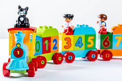 Toy train with wagons carries kids and cat (wuestenigel) Tags: childhood carriage fun game color vibrant preschool closeup concept blocks green locomotive transport background play red model train blue colorful child plastic travel vehicle transportation baby object railway toy yellow cartoon white spielzeug kind spas illustration isolated isoliert sketch skizzieren noperson keineperson abspielen robot roboter funny lustig kunststoff symbol image bild spiel business geschäft figurine figur miniature miniatur car auto graphic grafik alphabet