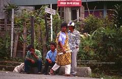Sumatra, Berastagi, waiting for the a bemo (minibus) (blauepics) Tags: indonesia indonesien southeast asia asien südostasien sumatra sumatera island insel berastagi city men männer locals einheimsiche people menschen minibus bemo station waiting warten watching schauen curious neugierig