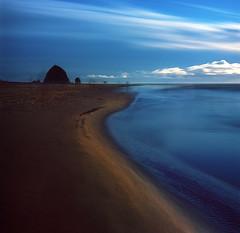 Sand, sea and sky (Zeb Andrews) Tags: hasselblad500c kodakektar cannonbeach oregon oregoncoast hasselblad film mediumformat 6x6 zaahphoto longexposure haystackrock pacificnorthwest landscape
