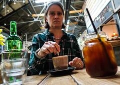 Framed by drinks (PChamaeleoMH) Tags: brickwood cafe coffee coveredmarket family people sister tootingmarket