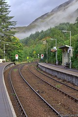 Glenfinnan Train Station (Canucklish) Tags: scotland scottishhighlands train traintracks mist rail station glenfinnan leadinglines mountain sky clouds