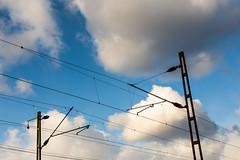 Outlook (Bela Bodo) Tags: sky blue clouds power pole abstract train rail electricity speed azure skies metal pillar