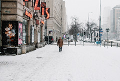Strolling in winter (ewitsoe) Tags: city nikon street warszawa winter erikwitsoe erikwitsoecom poland snow urban warsaw snowing pedestrians walking cityscape wintery ice cold day light travel polska