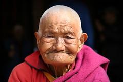 People of Nepal (Iam Marjon Bleeker) Tags: nepal boudhanath monk pink red peopleofnepal dag24md0c1099g
