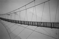 on an airy bridge (vldd) Tags: analog bridge yashica yashicaelectro35gx kodakgold200 40mm architecture winter snow fog mountains mist narrow