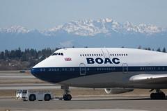 Retro livery BOAC Speedbird 747 being towed onto stand at Seatac (Niquinho) Tags: gbygc boac retrolivery speedbird ba100 seattle seatac
