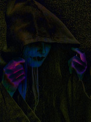 Witchy Woman (Steve Taylor (Photography)) Tags: witch hood digitalart blue green brown mauve purple lowkey eerie spooky weird odd strange woman lady newzealand nz southisland canterbury christchurch glow grain texture addington armageddonexpo armaggedon costume hands nosering stud