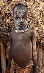 Karo Child (Rod Waddington) Tags: africa african afrique afrika äthiopien ethiopia ethiopian ethnic etiopia ethnicity ethiopie etiopian omovalley outdoor omo omoriver village valley valle culture cultural child girl portrait hut people painted face hunger