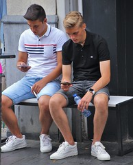 IMG_6633 (Skinny Guy Lover) Tags: outdoor people candid guys men males dudes sitting sit seated smartphones smartphonezombies bench shorts denimshorts