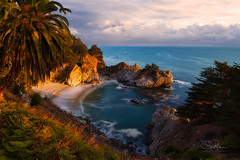 McWay Cove Sunset (TierraCosmos) Tags: mcwayfalls mcwaycove coast seascape bigsur california sunset sand beach waterfall palmtree clouds 10stop bigstopper