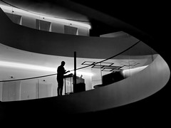 lounge DJ (heinzkren) Tags: schwarzweis blackandwhite bw sw monochrome panasonic lumix indoor human person man dj music loung hotel silhouette candid geomety architecture architektur lines