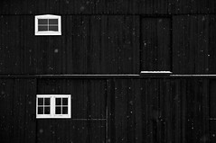 Winters Contrast (somewheredowntheroadphoto) Tags: barn light shadow shadows snow snowing nature bw blackwhite windows doors snowflake