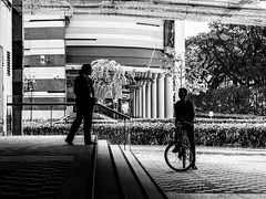 In conversation (Thanathip Moolvong) Tags: singapore centralregion sg candid talk conversation bw wb