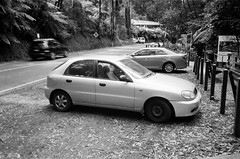 2001 Daewoo Lanos car (Matthew Paul Argall) Tags: canonsnappy20 fixedfocus 35mmfilm blackandwhite blackandwhitefilm kentmere100 100isofilm car vehicle automobile transportation daewoo daewoolanos carspotting