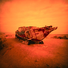 for want of water (xpro). bombay beach, ca. 2018. (eyetwist) Tags: eyetwistkevinballuff eyetwist abandoned sailboat boat bombaybeach california desert saltonsea film xpro orange yellow red lomo lca 120 minigon 38mm kodak ektachrome el400 el 400 crossprocessed crossprocess lomolca120 minigonxl38mmf45 kodakektachromeel400 expired iconla epsonv750pro lenstagger ishootfilm ishootkodak analog analogue emulsion square 6x6 mediumformat cross process processed vignette lomography lomographic lca120 ca111 sonorandesert landscape salton sea sand palmsprings yacht wood graffiti tagged water salt ruin wreck