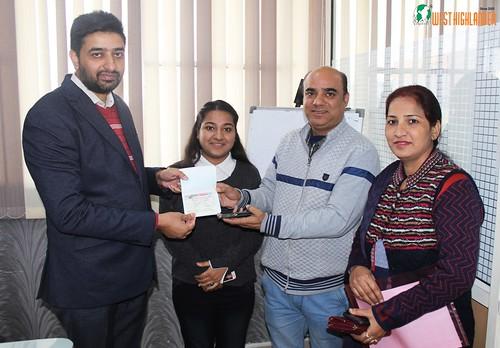 Mr. Gurvinder Kang (Director of West Highlander) handing over Canada Student Visa to Anmol Kalra