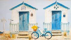 Bike & Beach Huts at the Seaside (Simon Downham) Tags: quaint pastel pastels seaside beach hutbeachhut bike flowers basket blue yellow lemon mustard kathrynwhite seagull fish lifebelt