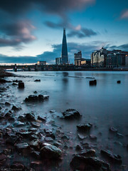 Blues at low tide (Through_Urizen) Tags: category citiestowns england london longexposure places riverthames theshard canon canon70d canon1585mm filters river water city skyline cityscape modernbuildings bridges buildings architecture glass rocks tide riverbank sky clouds motion greatbritain uk unitedkingdom building