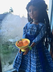 Selling Oranges in the Rain (Emily1957) Tags: rainyday oranges dolls doll light naturallight naturalgirlsunited toys toy rement barbie