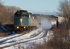 Whipped up Snow - Oxford Junction, NS (CWentzell Photography) Tags: via rail railroad railway passenger cn canadiannational springhill sub subdivision oxford junction jct reefer track tracks f40 emd motivepower locomotive locomotives engine engines stainlesssteel stainless budd budds canada novascotia canon photography adobelightroom landscape snow january 2019