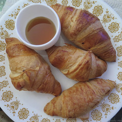 Croissants and Ghost Pepper Maple Syrup (Coyoty) Tags: traderjoes mini crescent rolls baked bakedgoods croissants butter flaky bread brown red plate pattern ghosted ghostpepper pepper ghost maple syrup maplesyrup square squareformat sweet puff pastry food cooking baking cooked hot spicy dip dipping circle round breakfast texture