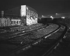 Tracks go left (ADMurr) Tags: la eastside commerce tracks night curve 4x5 arista ultra 100 dba286 bw black white monochrome film