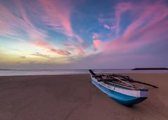 Sunrise over dickwella beach. (Chamikajperera) Tags: sri lanka travel canon sunrise boat beach landscape sky clouds sand waves