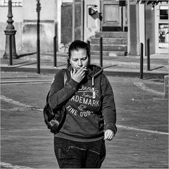 Retro trademark (John Riper) Tags: johnriper street photography straatfotografie square vierkant bw black white zwartwit mono monochrome budapest hungary candid john riper xt1 fuji 18135 authentic retro trademark fine goods girl woman cigarette