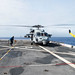 An SH-60S Sea Hawk helicopter spins on the deck of USS Green Bay during a training exercise with other U.S. Navy warships
