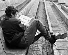Reading the newspaper (pedrosimoes7) Tags: reading readingnewspaper blackandwhite blackwhitepassionaward blackandwhiteonly opublico jornal fotoderua fotoperiodismo reader leitor