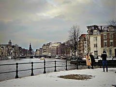 Winter on the Canal (Clare-White) Tags: amsterdam canal snow water buildings fence boats sky