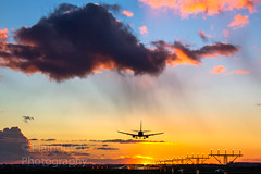 Sunset approach (Dennis-Dieleman) Tags: sunset clouds rain airplane aviation sun runway lights boeing 737800 schiphol amsterdam netherlands nederland airport vliegveld landing approach