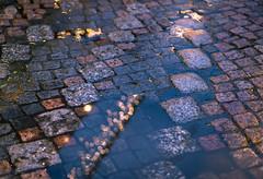 Reflections of a past Christmas (dlerps) Tags: amount centralgermany de daniellerps eu europa europe fullframe germany harz lerps lowersaxony mitteldeutschland niedersachsen norddeutschland northerngermany sony sonyalpha sonyalpha99ii sonyalphaa99ii lerpsphotography rain puddle wet reflection lights light floor street goslar christmasmarket christmas weihnachtsmarkt weihnachten carlzeiss carlzeissplanar50mmf14ssm