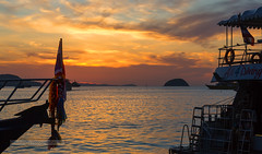 Sunrise at Chalong Bay, Phuket island, Thailand (Phuketian.S) Tags: sunrise chalong chalongbay boat yacht phuket thailand sea water landscape andamansea cruise sky nature morning sun cloud shadow silhouette phuketian пхукет таиланд яхта лодка море восход природа океан андаманскоеморе облака рассвет солнце sunset ocean skyline bay mountain people photo