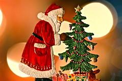 "Trimming the Tree - Macro Monday - ""Holiday Bokeh"" (not beck) Tags: macromonday macro monday holidaybokeh holiday bokeh christmas tree santa santaclaus decorating decoration lights red green presents german paint pewter"