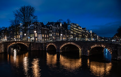 Quintessentially Dutch... (Aleem Yousaf) Tags: keizersgracht reguliersgracht dutch amsterdam canal lights blue hour leidsegracht dusk reflections arch bridge netherlands nederlands 2470mm people tourist travel digital outdoor camera nikon nikkor d810 photo walk north nieuwe sky clouds long exposure