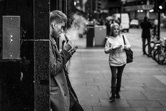 Screen Time (Leanne Boulton) Tags: urban street candid portrait streetphotography candidstreetphotography candidportrait streetlife man male smoke smoker smoking vape vaper vapour vaping mobile smartphone face expression tone texture detail depthoffield bokeh grain naturallight outdoor dark light shade city scene human life living humanity society culture lifestyle people canon canon5dmkiii 70mm ef2470mmf28liiusm black white blackwhite bw mono blackandwhite monochrome glasgow scotland uk