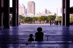 Afternoon with Grandma (jeremy_d_smith) Tags: dogwood52weekphotochallenge dogwood fuji fujifilm fujinon xt1 xf35mm fujixseries xseries fujix kaohsiung taiwan city street streetphotography people publicspace culturecenter urban