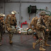 Marines carry a simulated casualty atop the flight-deck aboard the USS Wasp