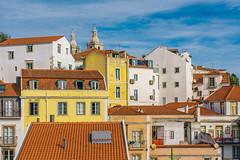 Alfama, Lisbon (Sorin Popovich) Tags: lisbon lisboa houses colourful portugal urban architecture capitalcities multicoloured facade traditionalportuguese church alfama roofs rooftops skyline europe