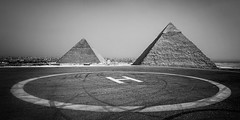 Great Pyramids of Giza, Egypt (pas le matin) Tags: travel voyage world egypt égypt afrique africa cairo lecaire pyramid giza gizeh pyramide ancient antique antiquité antiquity architecture h héliport heliport landing nb bw noiretblanc blackandwhite monochrome greatpyramide sand sable ruin ruins ruines canon 7d canon7d canoneos7d eos7d greatpyramidofkhufu pyramidofkhufu khufu pyramidofcheops pyramidedekhéops grandepyramidedegizeh pyramidedegizeh khéops pyramidedekhéphren khéphren pyramidofkhafre khafre pyramidofchephren chephren