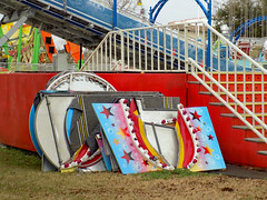 Scenery Panels And Stairs. (dccradio) Tags: myrtlebeach sc southcarolina robesoncounty outdoor outdoors outside amusementpark park broadwayatthebeach pavilionpark pavilionparkcentral pavilionamusementpark pavilionamusementparkcentral carnival midway fairride amusements amusementdevice mechanicalride ride rides thrillride outdooramusement fun entertainment nikon coolpix l340 bridgecamera sky cloudy overcast greyskies grayskies color colorful slide superslide funslide giantslide carnivalslide scenery scenerypanels panels grass ground steps stairs railing
