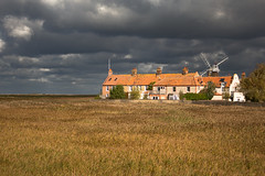 Ominous (music_man800) Tags: cley marshes marsh windmill mill wind norfolk reeds reedbeds houses buildings row old vintage pretty beautiful rustic british english uk united kingdom holiday october half term windy walk hike clouds cloudy moody stormy ominous spectacular amazing lighting weather unsettled rolling orange rooftops yellow colours colourful nature natural light scene view scenery canon 700d adobe lightroom creative cloud edit photography arty artistic atmospheric sun sunny sunlight intervals