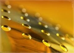abstract holes (sure2talk) Tags: macromondays holes abstractholes spoon slottedspoon stainlesssteel colours reflections light macro closeup nikond7000 nikkor85mmf35gafsedvrmicro 119picturesin201976themundanemadeinteresting shallowdof bokeh abstract kitchen tool