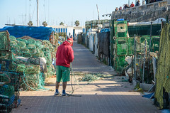 After the fishing there's still work to be done (TeylorDelight) Tags: fisherman dock cascais red green baskets traps rope pescador redepesca verde sky ceu portugal