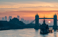 A New Dawn... (Aleem Yousaf) Tags: bike ride flickr morning light river thames sun frame sunrise golden hour water glow tower bridge hms belfast buildings haze mist fog silhouette historical monument architecture platform london reflections nikkor nikon 70200mm contrasts flags construction cranes towers canary wharf muted colours fire sky cloudsneutral density graduated shadows cityscape capital england great britain city naval ship gold happy design day winter 2019 february