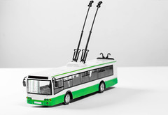 Toy plastic model of a trolley bus (wuestenigel) Tags: trolleybus electric street retro auto urban transport automotive carrier transportation bus green trolleymodel toy automobile trolley white vehicle fahrzeug car transportationsystem transportsystem noperson keineperson travel reise truck lkw isolated isoliert business geschäft outdoors drausen