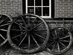 horse cart wheels (j.p.yef) Tags: peterfey jpyef yef germany ranch bauernhof museum monochrome bw sw house window cartwheels old aoi elitegalleryaoi bestcapturesaoi