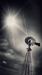 blazing new trails...(HWW) (BillsExplorations) Tags: windmill windmillwednesday waterpump trails contrails hww vintage old sepia sun clouds snapseed new