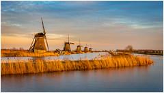 Golden hour at Kinderdijk (Rob Schop) Tags: kinderdijk goldenhour sonya6000 windmill lights color unesco sky zuidholland nederland pola hoyaprofilters lrcc prime sigma30mm14
